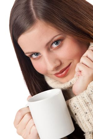 Winter portrait of happy woman holding cup of coffee wearing turtleneck on white photo