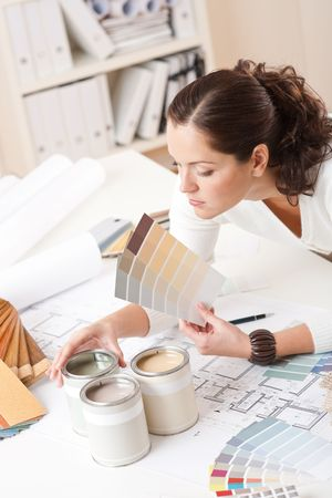 Young female interior designer at office with paint and color swatch Stock Photo - 5977593