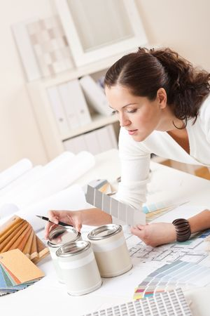 Young female interior designer at office with paint and color swatch Stock Photo - 5996505