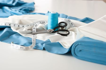 to sew: Fashion designer studio with professional equipment on desk, cloth, scissors