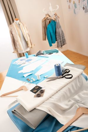 Fashion designer studio with professional equipment, sketches, mannequin, cloth Standard-Bild