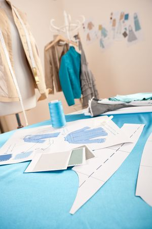 work material: Fashion designer studio with professional equipment, sketches, mannequin, cloth Stock Photo