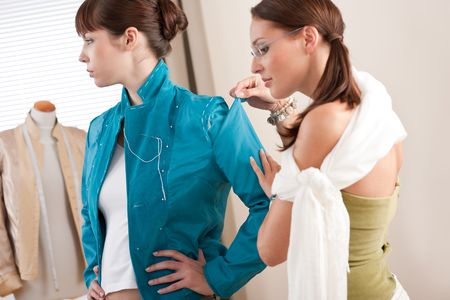 customer tailor: Model fitting by professional female fashion designer studio