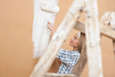 Home improvement: Woman painting wall photo