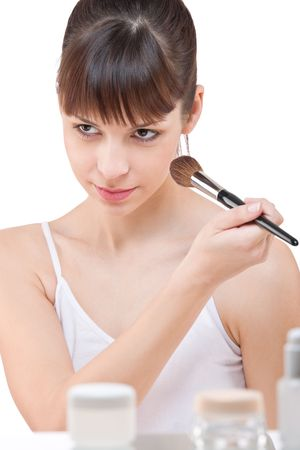 Body care: Young woman applying powder with make-up brush on white background Stock Photo - 6221159