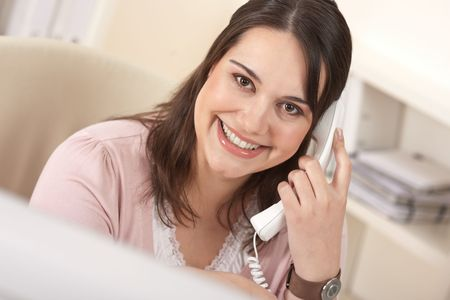 Portrait of young business woman working on the phone Stock Photo - 6327436