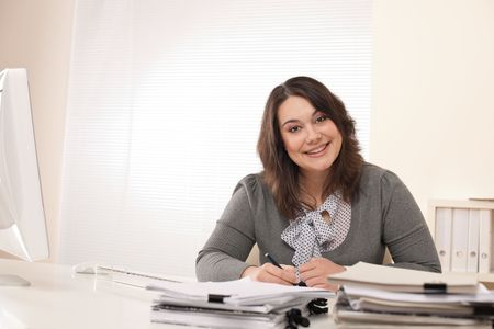 Young business woman working at modern office with computer photo