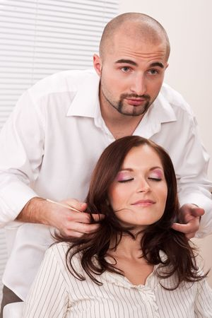 Professional male hairdresser comb female customer at salon Stock Photo - 6418678