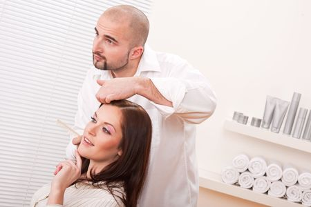 Professional male hairdresser comb female customer at salon Stock Photo - 6418703