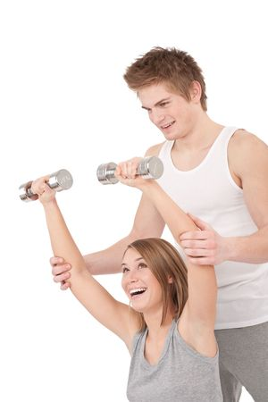 Fitness - Young woman with instructor lifting weights on white background Stock Photo - 6418709