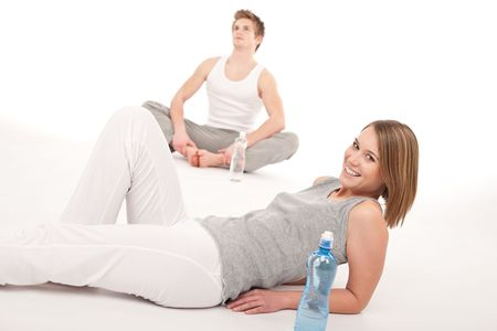 pilates man: Fitness - Healthy couple stretching after training on white background