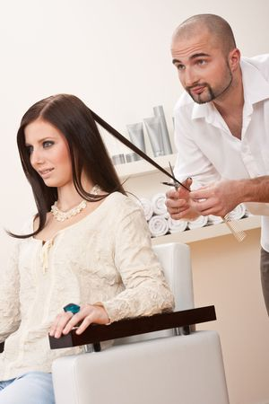 Professional male hairdresser cut with scissors at salon, customer getting new haircut Stock Photo - 6452902