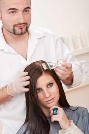 Professional male hairdresser color female customer at design salon Stock Photo - 6452894