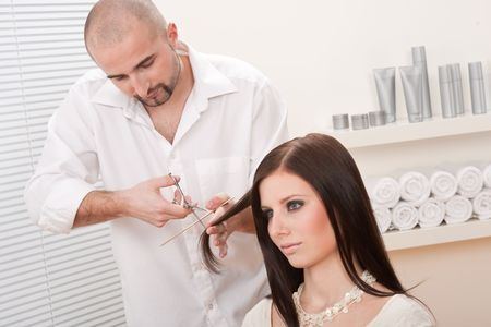 Professional male hairdresser cut with scissors at salon, customer getting new haircut Stock Photo - 6465424