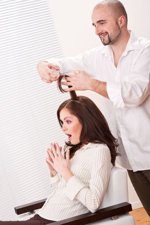 Professional male hairdresser cut with scissors at salon, customer getting new haircut Stock Photo - 6465427