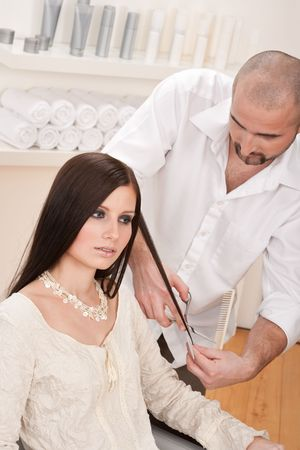Professional male hairdresser cut with scissors at salon, customer getting new haircut Stock Photo - 6465406