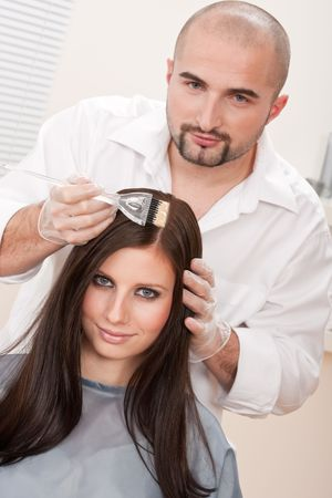 Professional male hairdresser color female customer at design salon Stock Photo - 6465441
