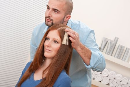 Professional male hairdresser choose hair dye color at modern salon, female customer change hair color Stock Photo - 6478014