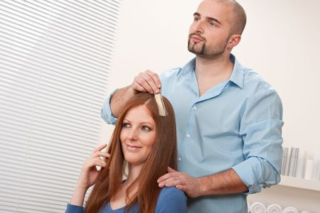 Professional male hairdresser choose hair dye color at modern salon, female customer change hair color Stock Photo - 6478025