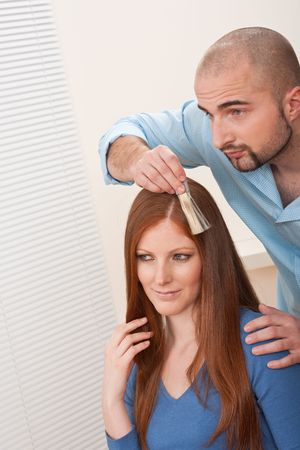 Professional male hairdresser choose hair dye color at modern salon, female customer change hair color Stock Photo - 6478680