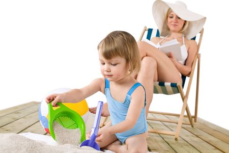 Beach - Mother with child playing with toys in sand Stock Photo - 6593881