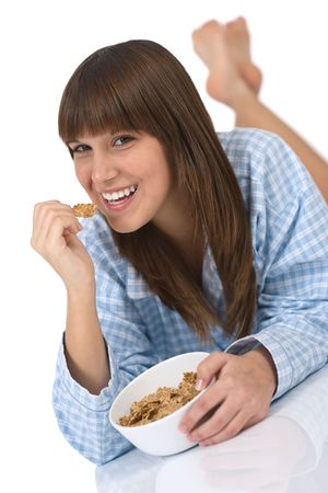 Female teenager eat healthy whole wheat cereal for breakfast Stock Photo - 6620200