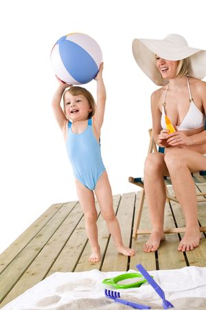 Beach - Mother with child on wooden planks play with beach toys photo