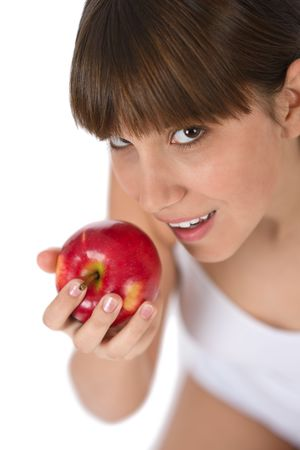 Female teenager eat red apple on white background Stock Photo - 6679887