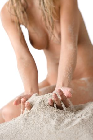 naked female body: Part of naked female body on beach, woman sunbathing, body covered with sand
