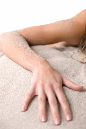 nudist: Beach - Part of female body, hand  covered with sand