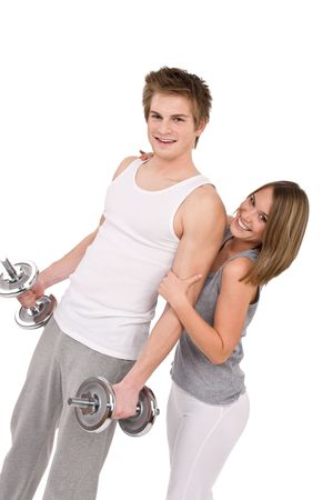 Fitness - Smiling healthy couple exercising with weights on white background photo