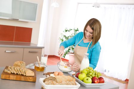 cook house: Baking - Smiling woman with healthy ingredients prepare organic dough Stock Photo