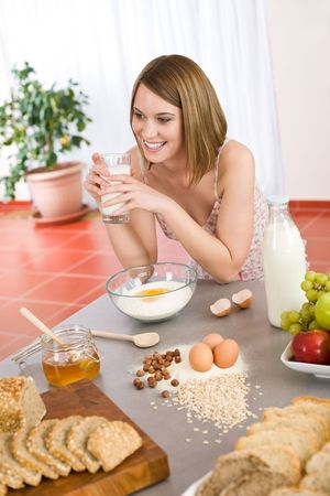 Baking - Happy woman prepare healthy ingredients for organic cake dough Stock Photo - 6801821