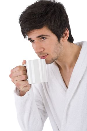 Morning - Young man in bathrobe with cup of coffee on white background Stock Photo - 6839758