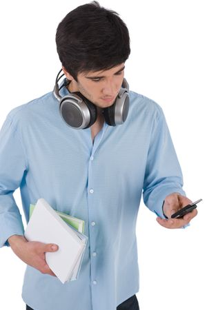 Male student sending text message holding books on white background Stock Photo - 6839813