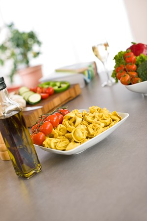 Italian food - pasta, tomato and olive oil, ingredients for cooking photo