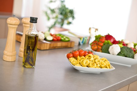 Italian food - pasta, tomato, ingredients for cooking in kitchen photo