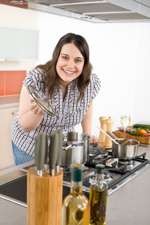 Cook - plus size woman in modern kitchen prepare meal photo
