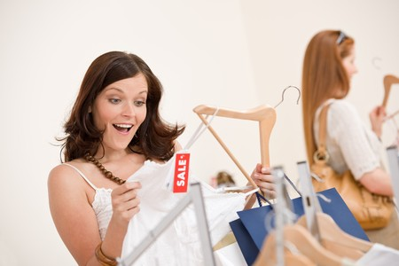 Fashion shopping -  Two happy young woman choose clothes in shop Stock Photo - 7169693