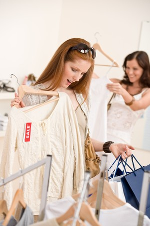 Fashion shopping -  Two happy young woman choose clothes in shop Stock Photo - 7169736