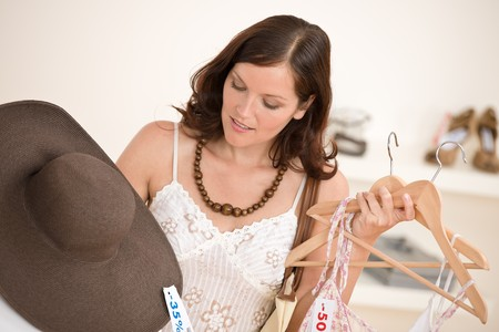Fashion shopping - Happy woman choose sale clothes, holding shopping bag Stock Photo - 7169750