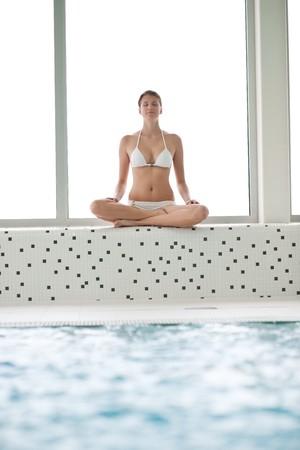 Swimming pool - beautiful woman wearing bikini, relax by pool photo