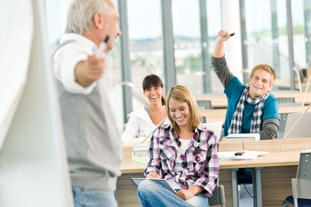 High school - three students with mature professor in classroom Stock Photo - 7825859