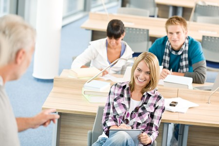 High school - three students with mature professor in classroom Stock Photo - 7835339