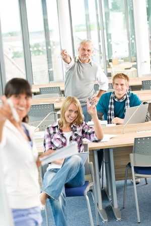 High school - three students with mature professor in classroom Stock Photo - 7835360