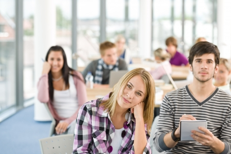 Class at high school - students in classroom writing notes during session photo