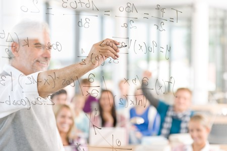 Math lesson at high school - students with professor in classroom photo