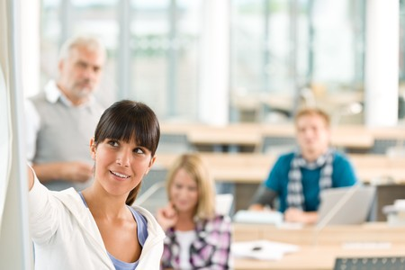 High school - three students with mature professor in classroom photo