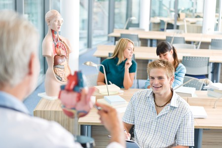 anatomical model: University - medical students with professor and human anatomical model in classroom