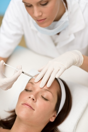 latex: Woman in cosmetic medicine treatment getting botox injection, close-up portrait
